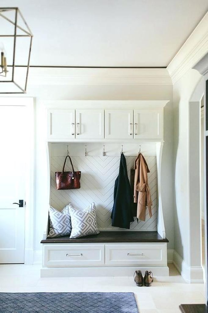 Modern entryway ideas with hooks to keep your bag and coat in your entryway