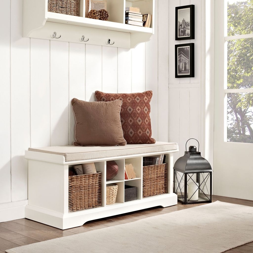 Modern wooden storage bench with storage basket below it and cushion to perfect your entryway decor