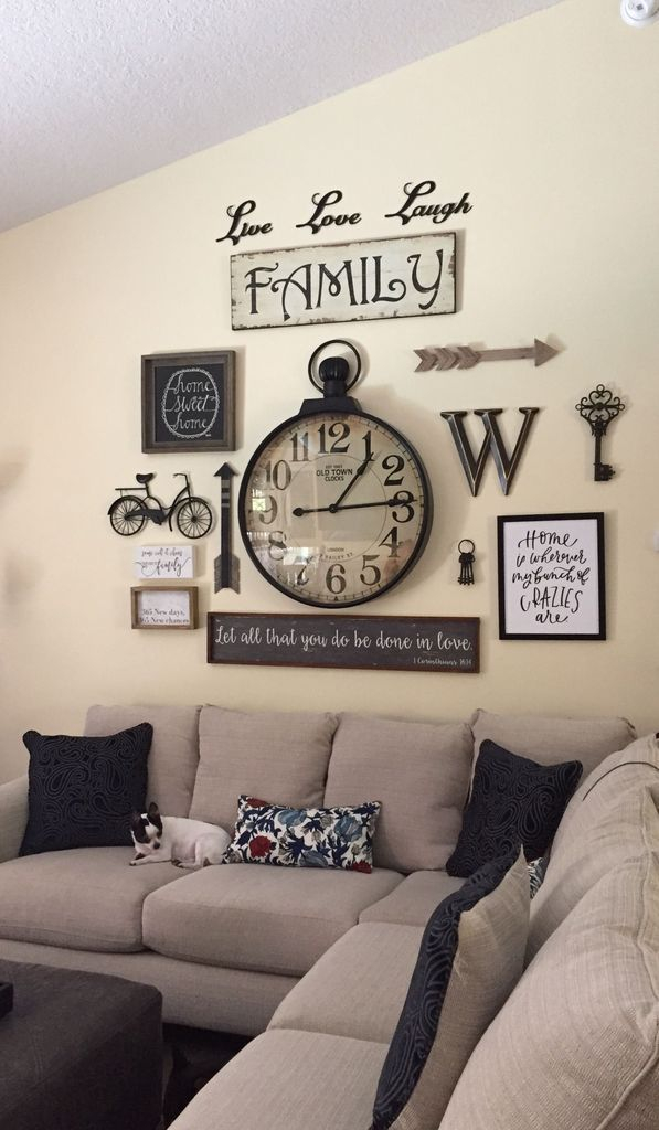 Old clock in the middle wall gallery to perfect your living room