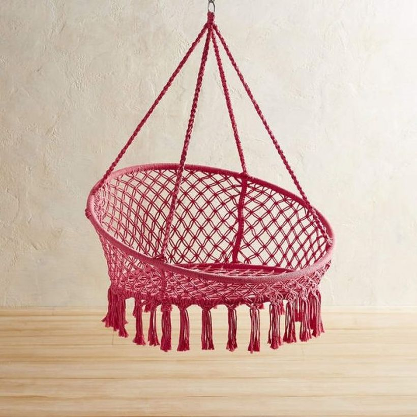 Pink macrame saucer swing chair.