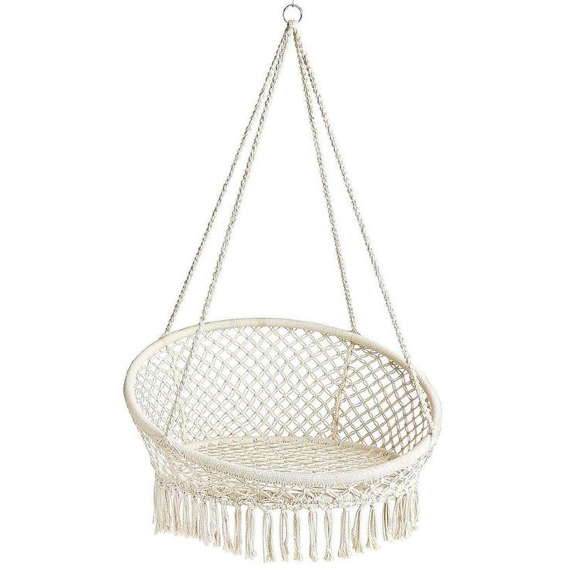 Round small white macrame hanging saucer chair.