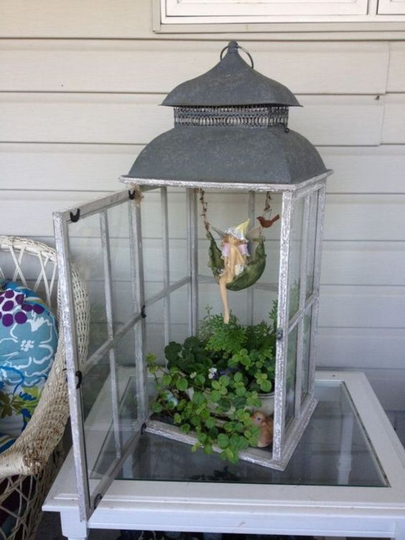Rustic lantern terrarium with white wooden lantern, greenery, and small fairy for your home decor