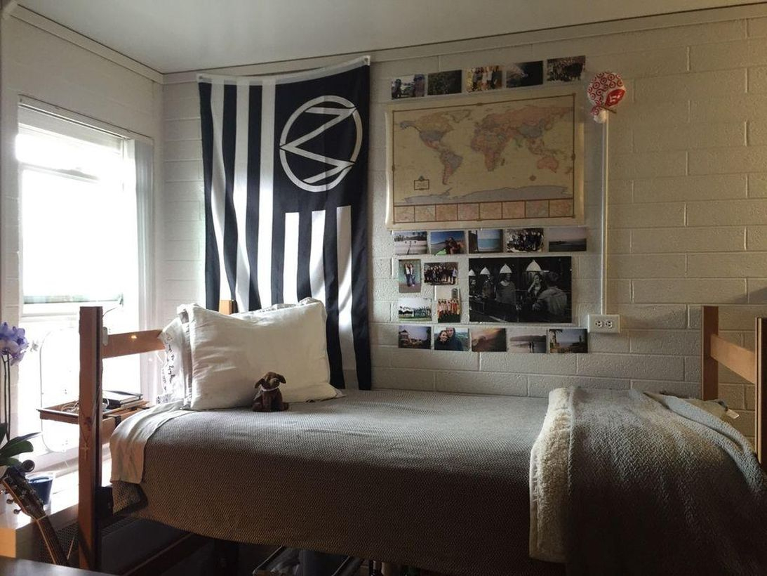 Simple boys room decoration with gray mattress, gray blanket, white pillow, photo picture for wall decoration for good looking
