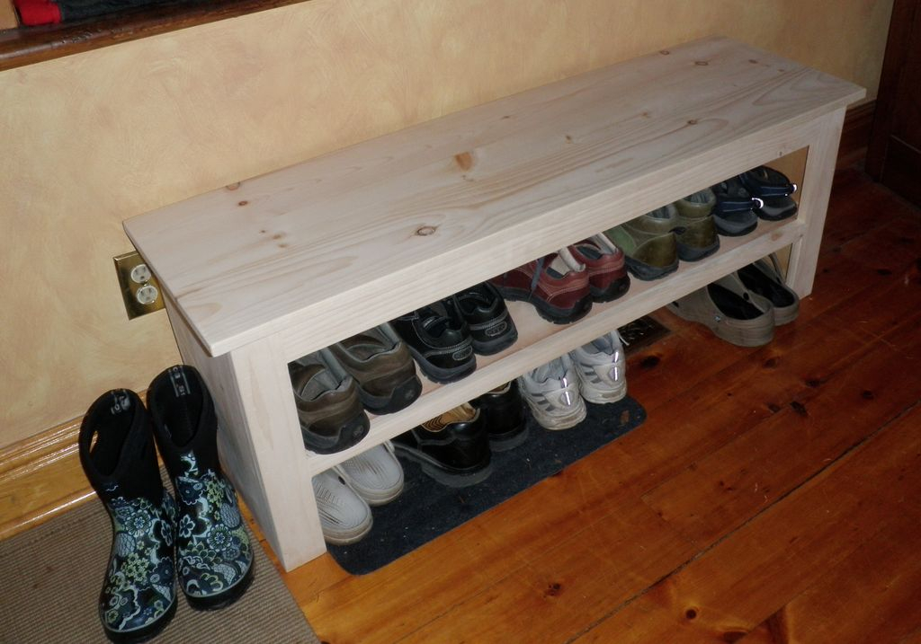 Simple wooden storage bench with shelf underneath to store your shoes