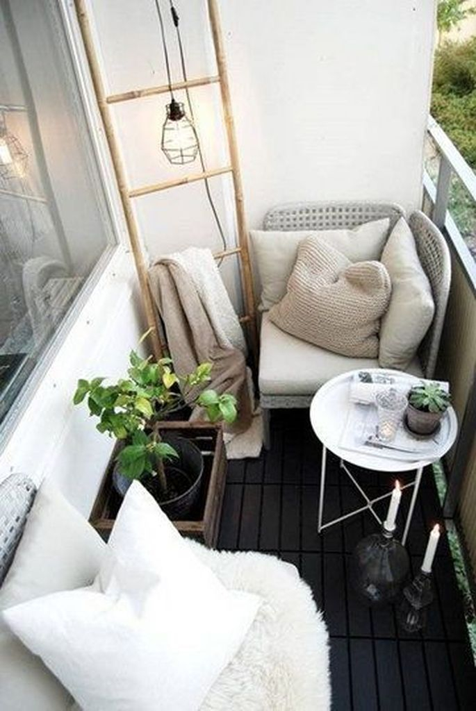 Small balcony with round table and plant decoration