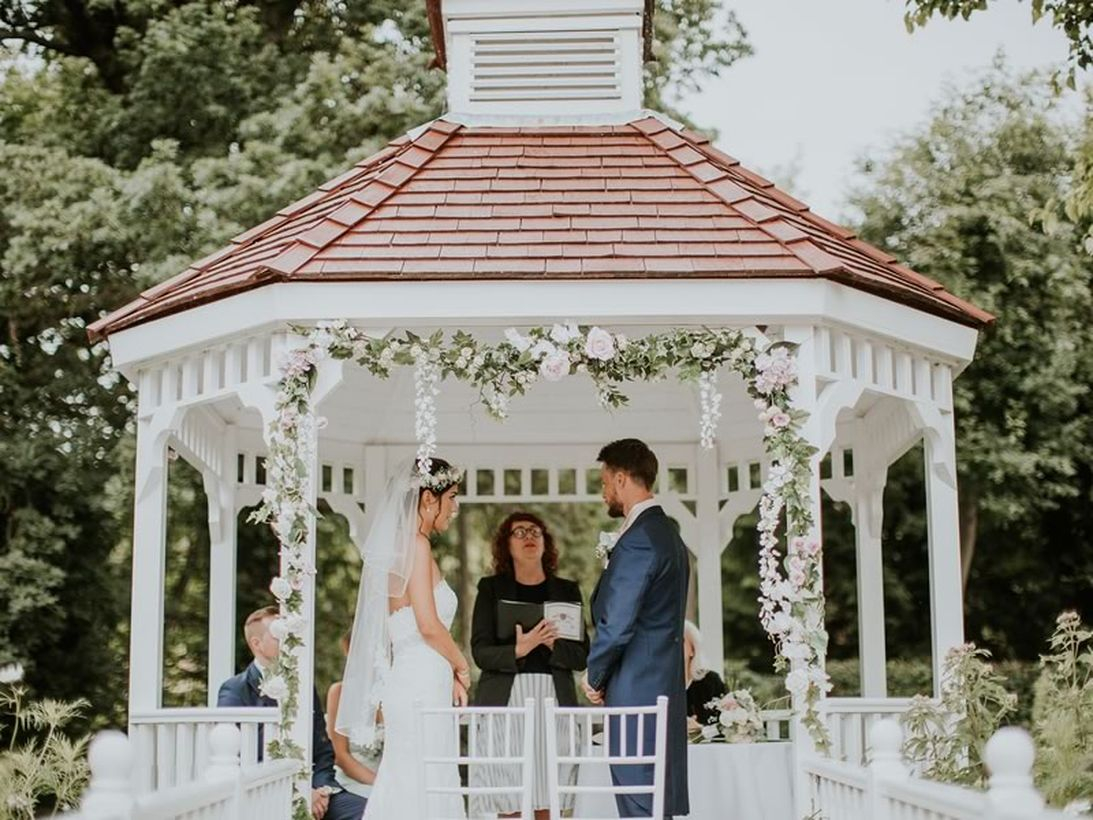 Venue wedding decoration with arrangment flower arch on pergola to look an elegant