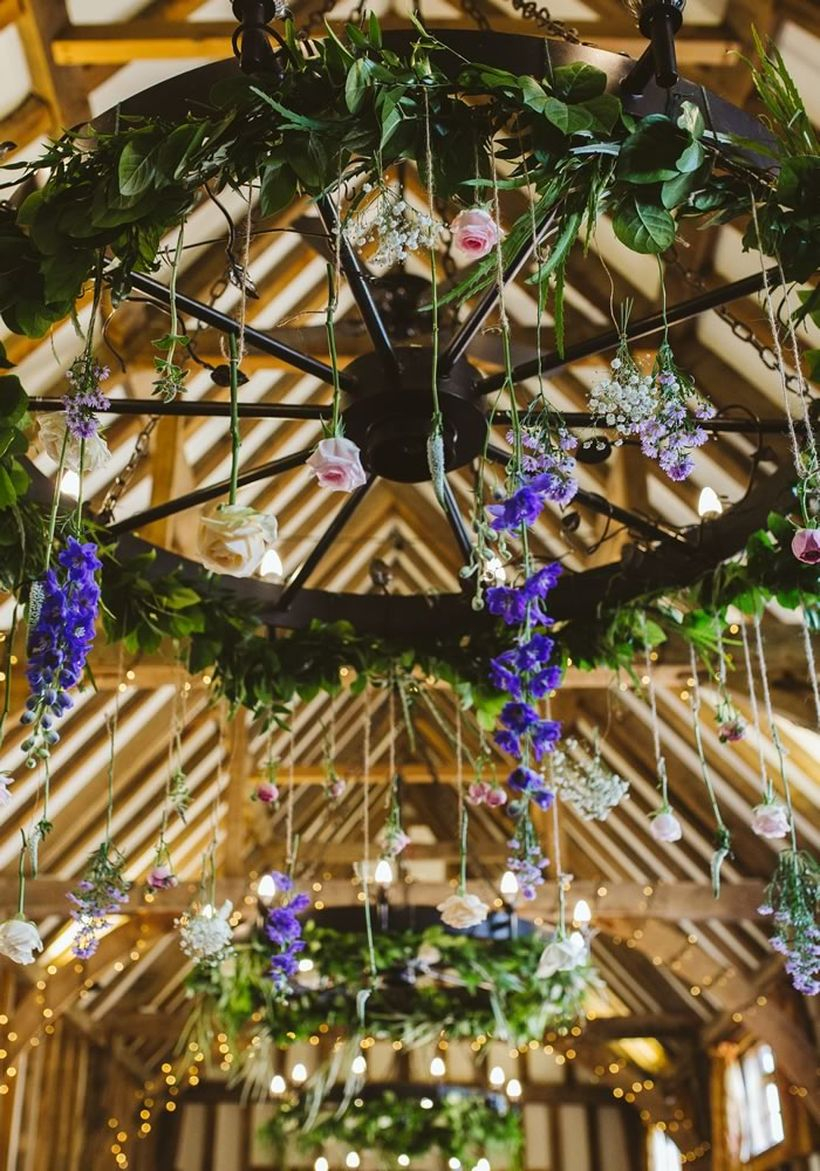 Venue wedding decoration with trailing flowers and foliage wreaths to create whimsical suspended centrepieces to create a fancy
