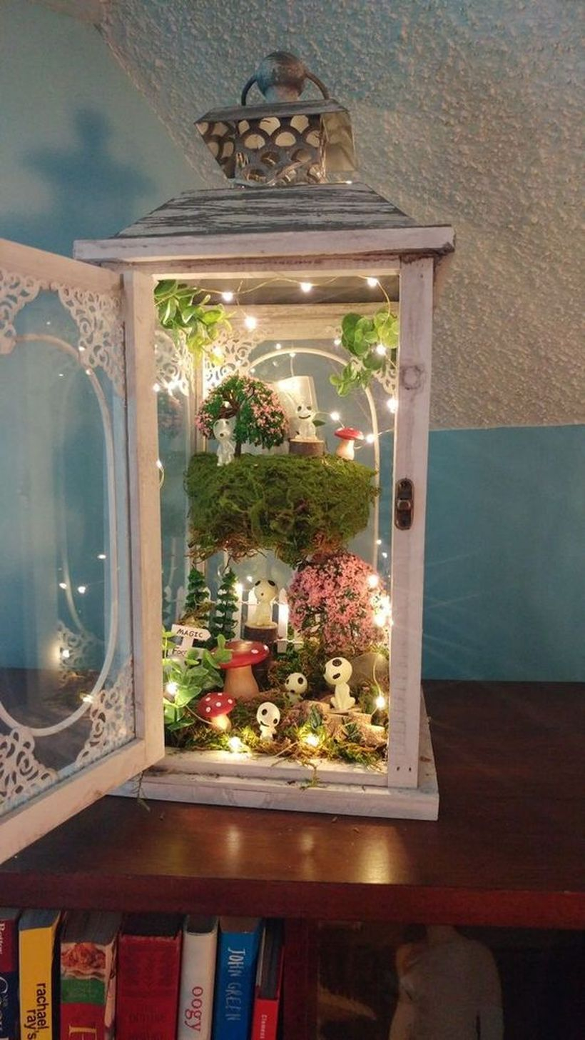 White lantern terrarium with decorative lighting to create beautify for your home