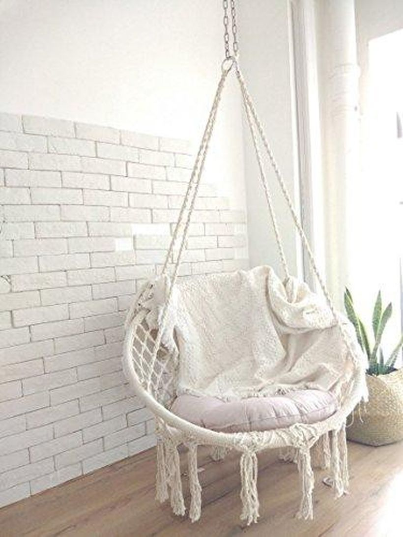 White hanging macrame chair.