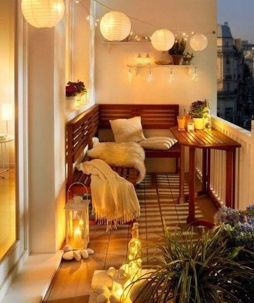 Wooden cahair combined with perfect lighting to perfect your balcony