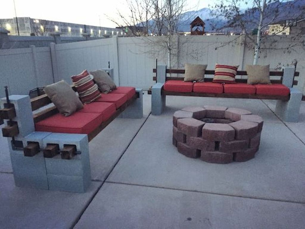 Wooden outdoor bench with fireplace