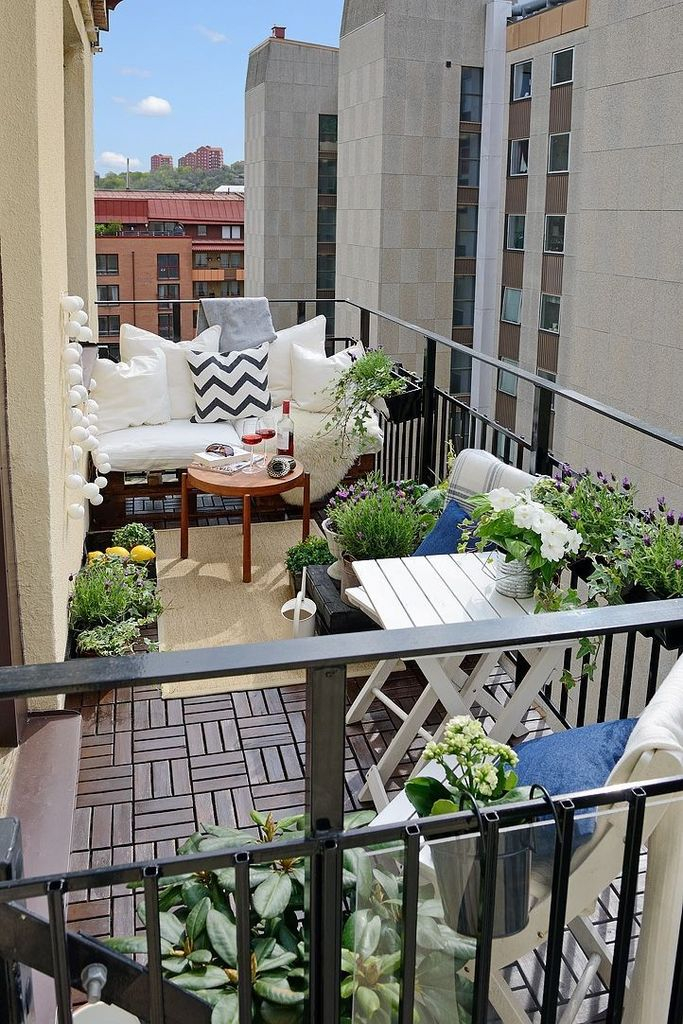 Wooden table and plants decoration to perfect your balcony