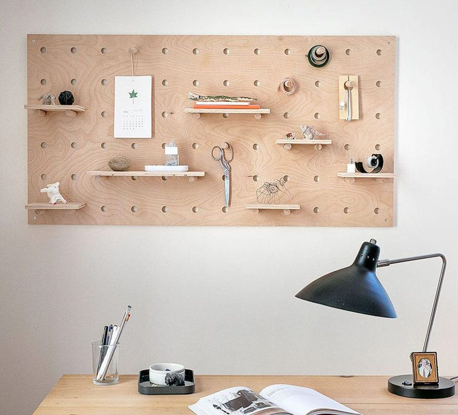 Creative pegboard shelves would be perfect for your home office desk to hang small ornament