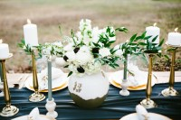 Decorate wedding table with centerpiece and candle handles to create romantic atmosphere
