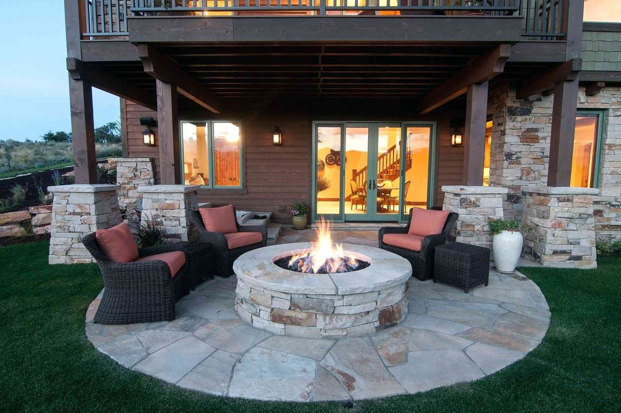 Fire pit from wooden with rattan chair