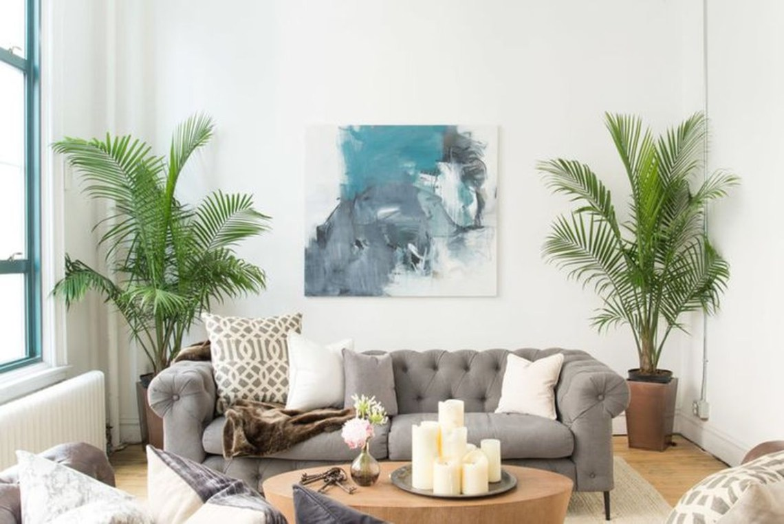 Gorgeous greenery for home decoration ideas with palm tree at the corner for your living room