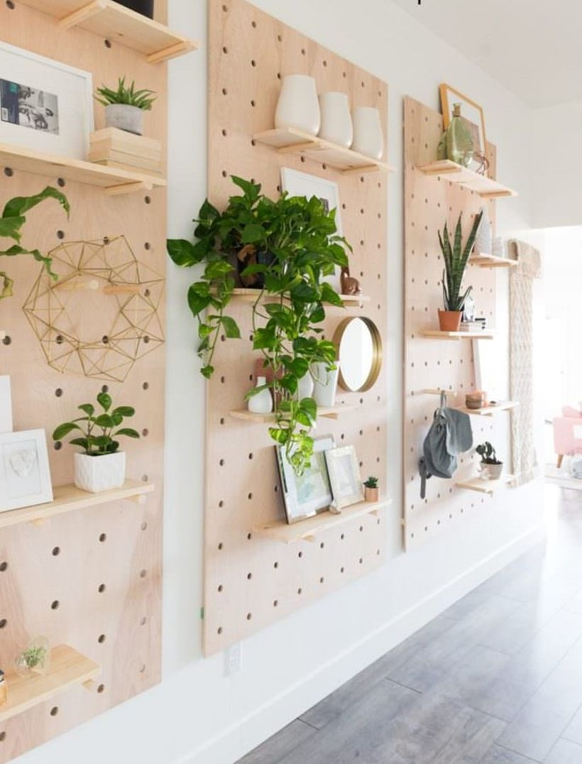 Gorgeous pegboard organization rack to put some ornament home and house plant in your living room