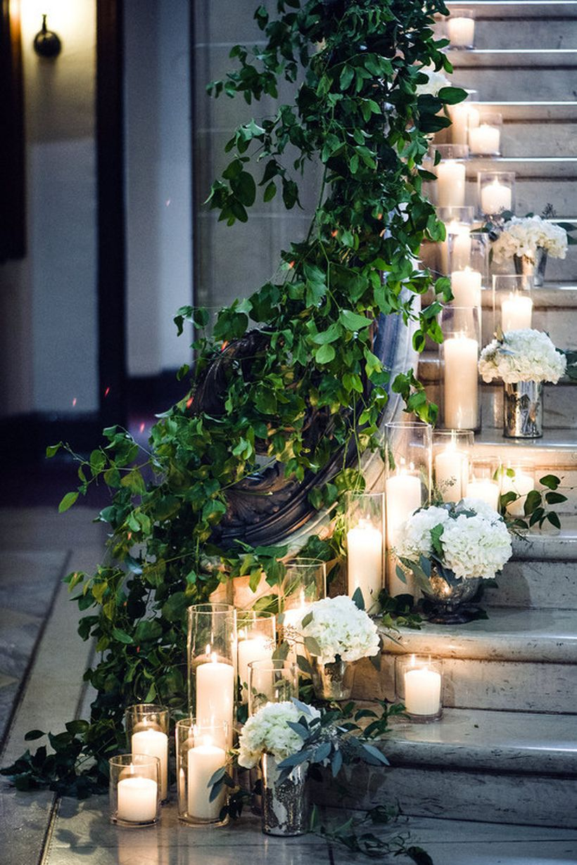 Guide guests from point a to point b with decorative candle and greenery to create romantic atmosphere
