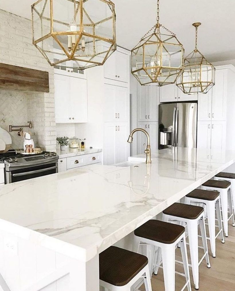 Long square white countertop design with white and black chairs