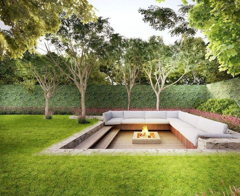 Modern square fire pit and white sofas