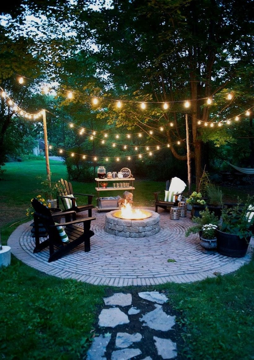 Outdoor fire pit with decorative lighting