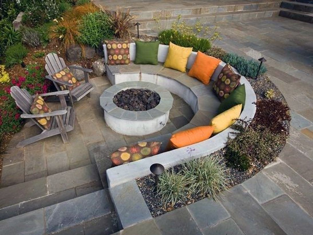 Outdoor fire pit with sofa cushions