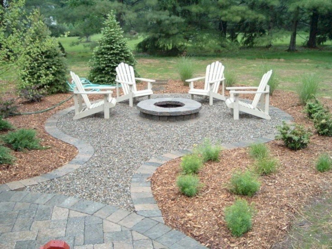 Round stone fire pit and white wooden chair