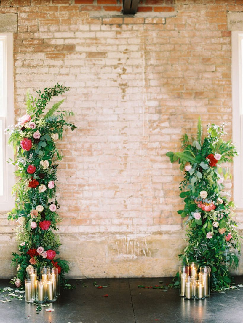 Rustic backdrop wedding decoration with floral accents and arrangement candles