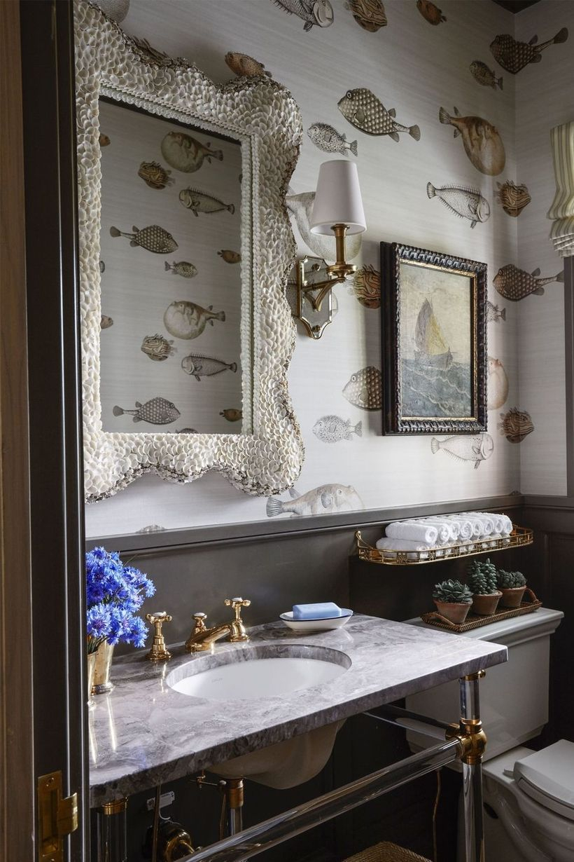 Simple small bathroom with beach house wallpaper so that it displays a different atmosphere