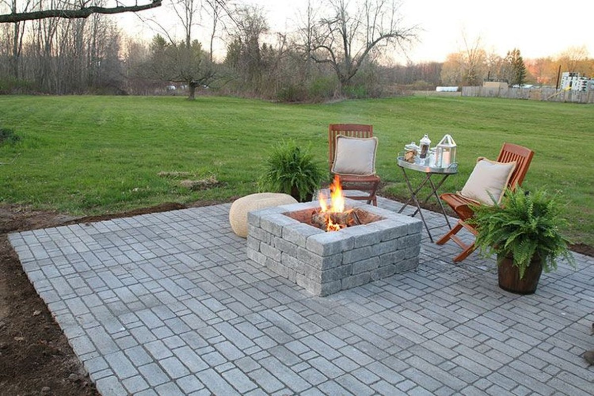 Square shaped fire pit with stones