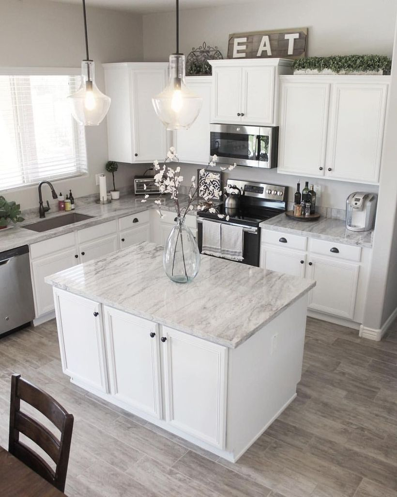 White marble countertop design on white cabinet