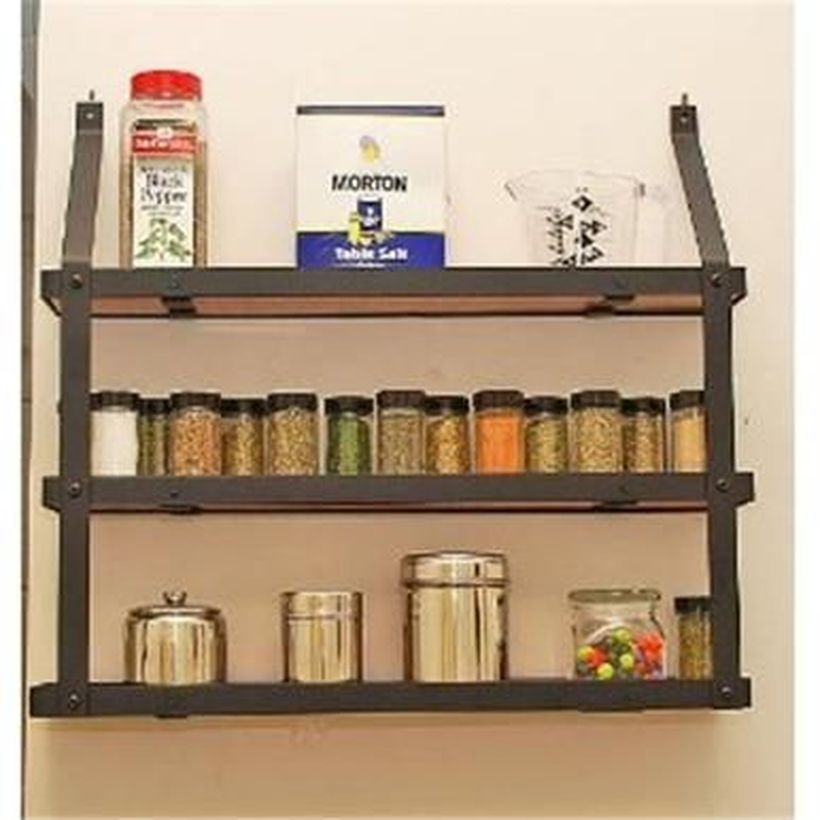 Wooden spice rack on the wall