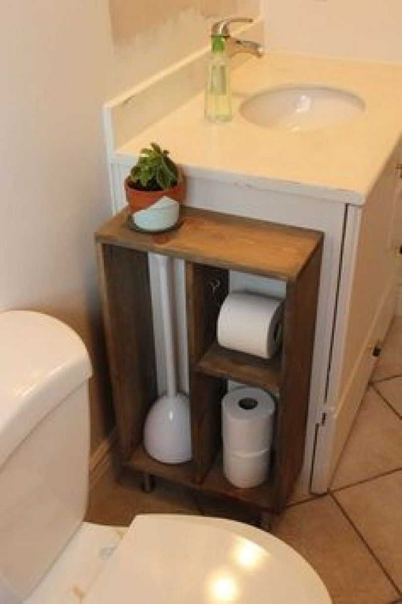 Wooden storage on besides a sink