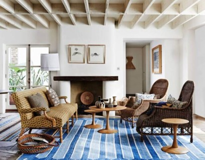 An awesome living room with round wooden table, brown sofa, white walls for wonderful decor