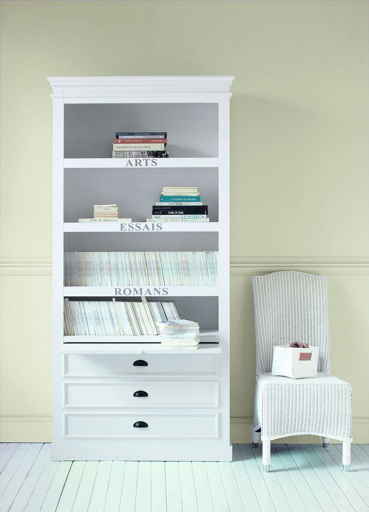 An amazing book storage ideas for a small bedroom with a labelled bookcase in white to perfect your bedroom