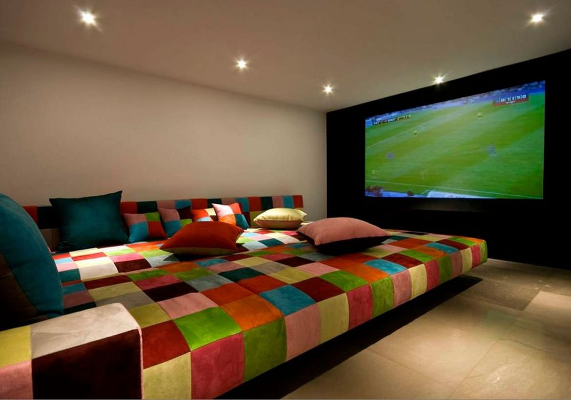Basement with colorful sofa and big tv