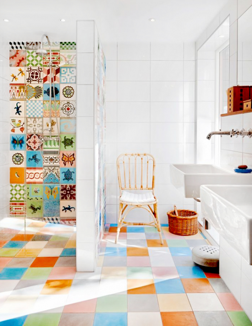 Beautiful bathroom with square colorful tile, rattan chair, and white sink to look awesome