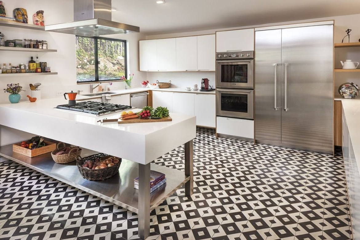 Black and white small patteren kitchen-tile floor with white cabinet and simple white table