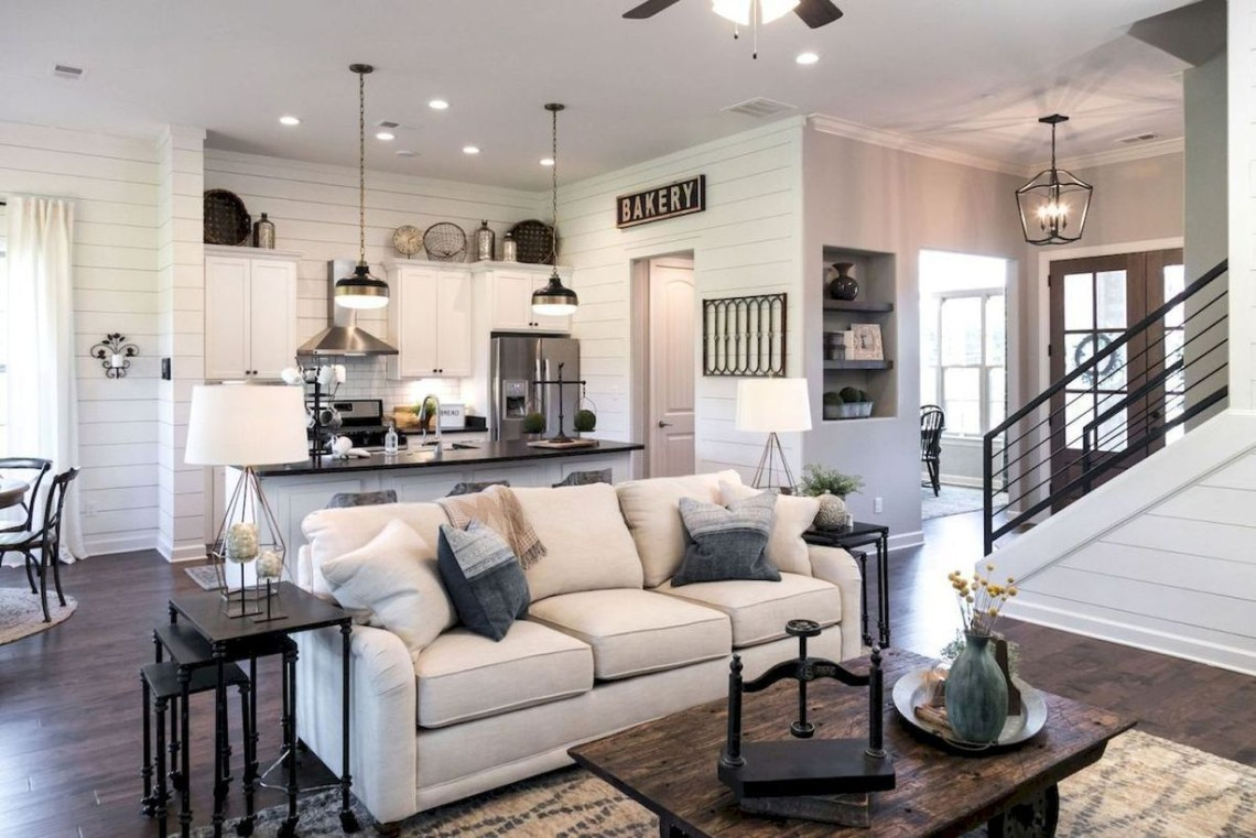 Cozy living room with unique hangig lamps, white sofa and wooden table for amazing decoration