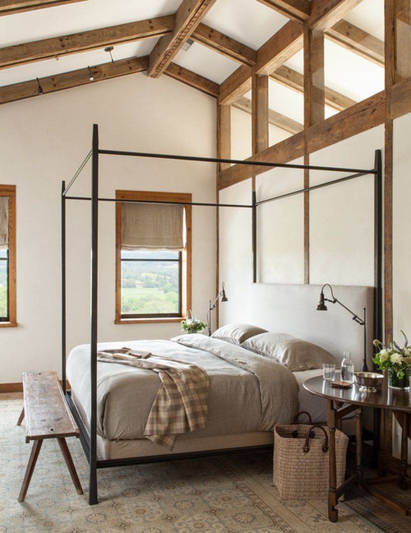 Incridible bedroom with black iron bedstead, gray bed, long square wooden chairs to look good