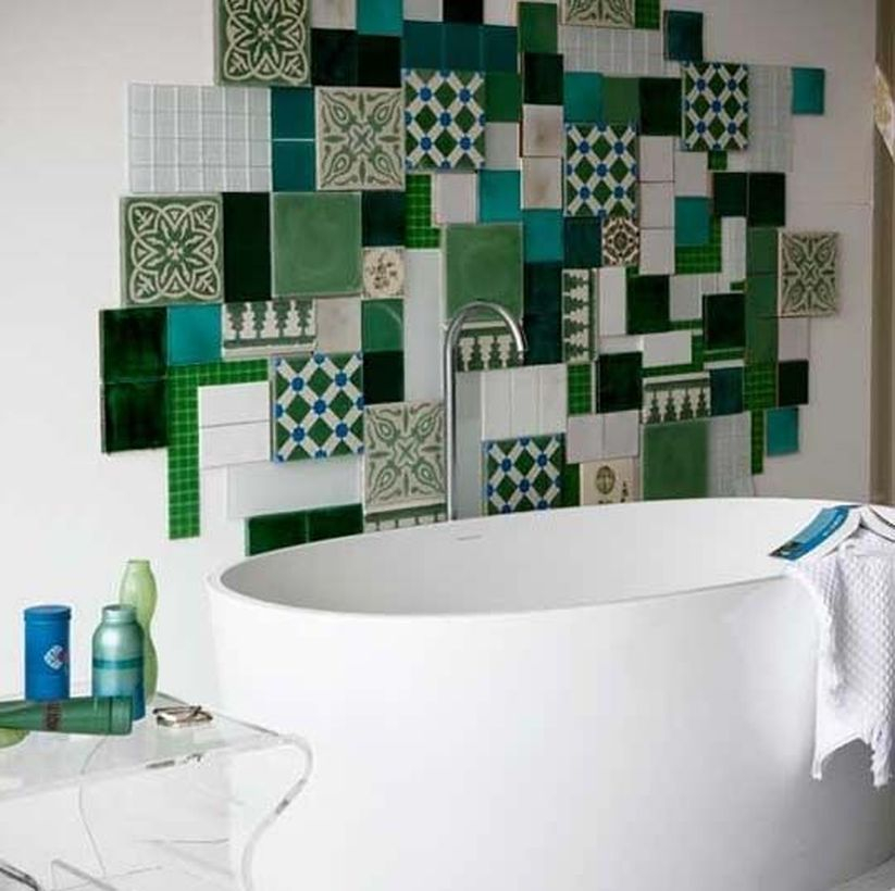 Indridible bathroom with colorful wall, white bethup to look cool