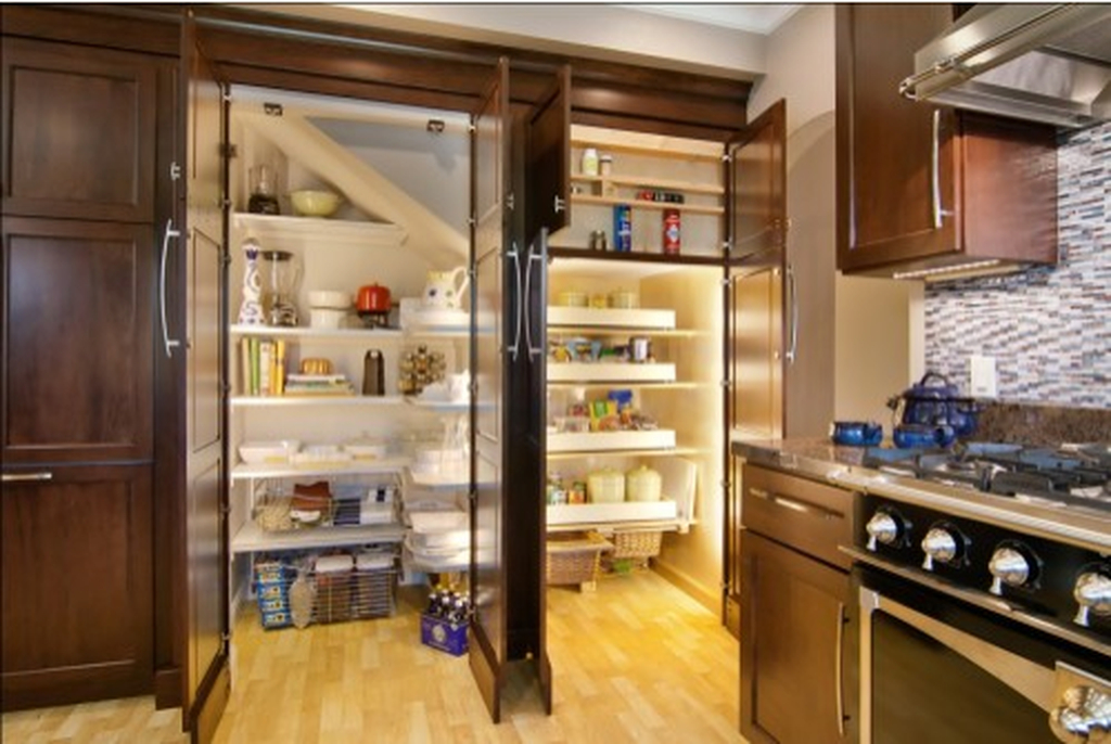Modern kitchen pantry with white shelves