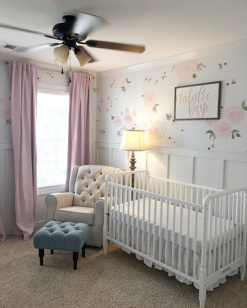 Simple-baby-girls-nursery-room-with-wooden-white-bed-floral-wallpaper-and-floor-lamp-to-decorative-light-in-your-home