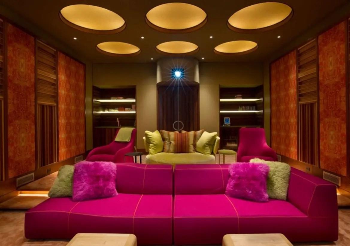 Basement move room with pink sofa and modern lighting