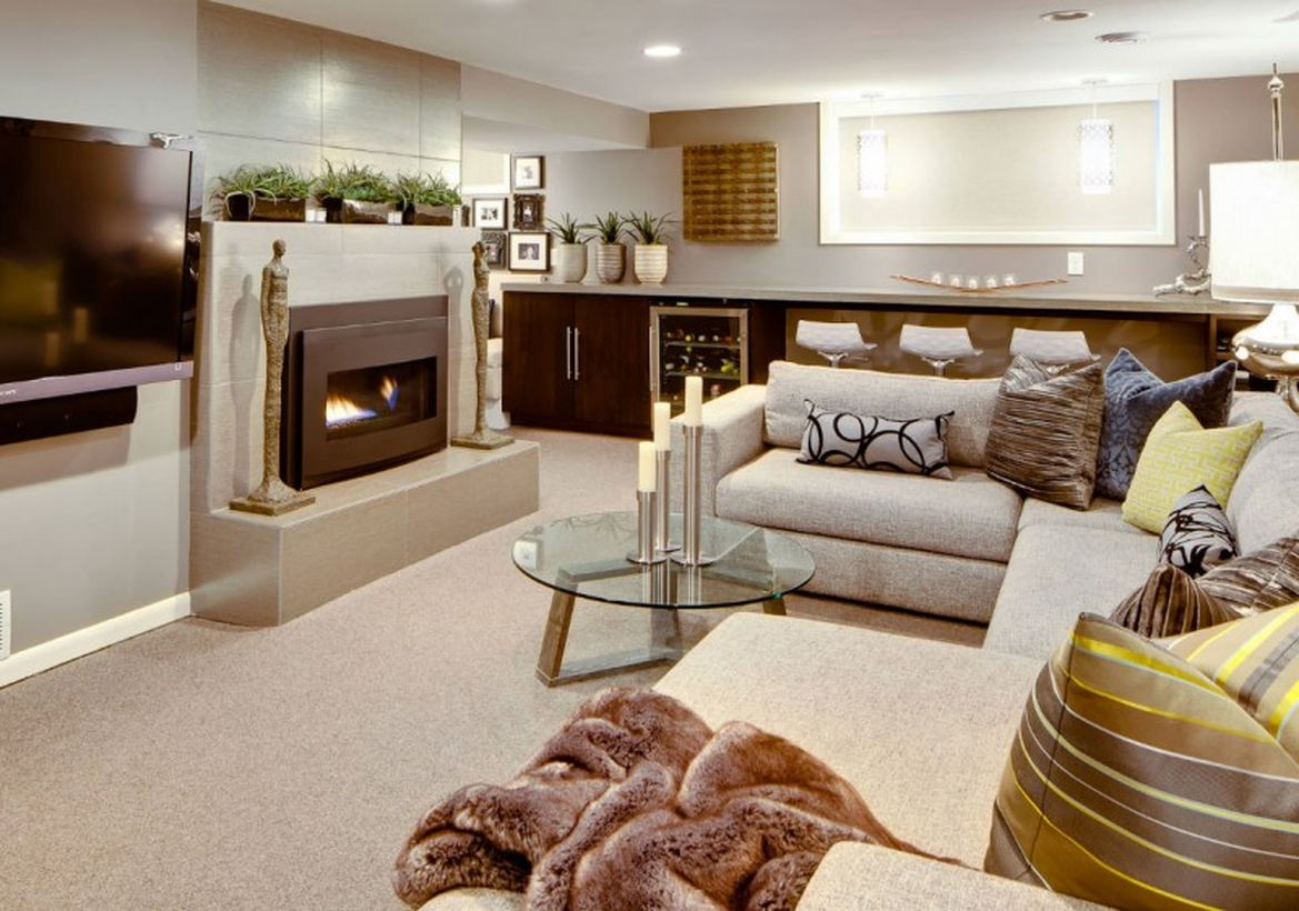 Basement with white liwing room and bar decoration