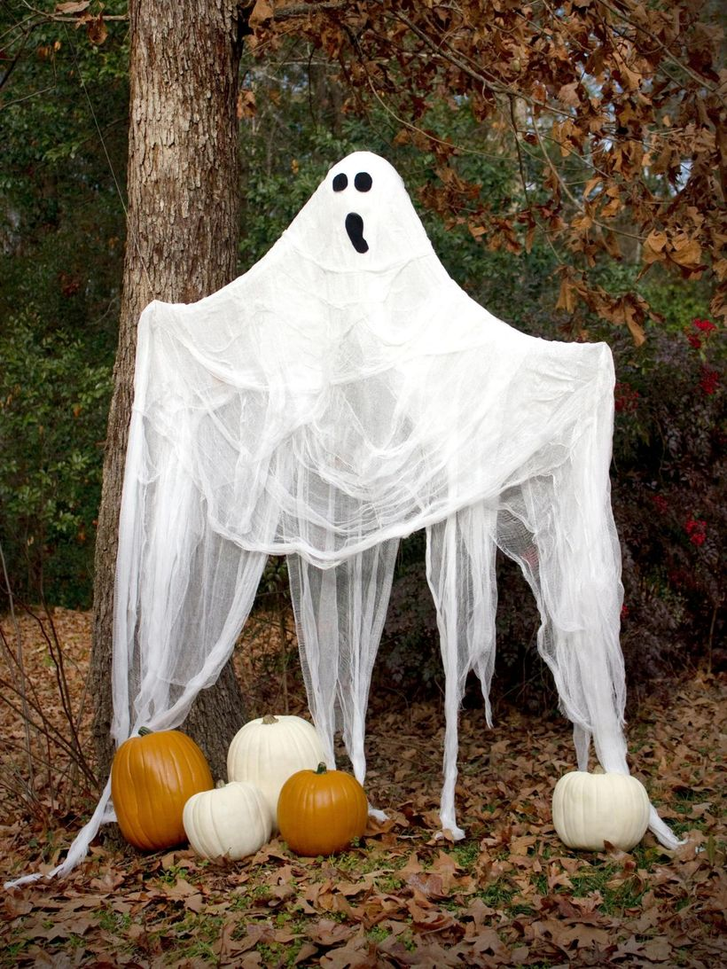 Ghost halloween with pumpkins