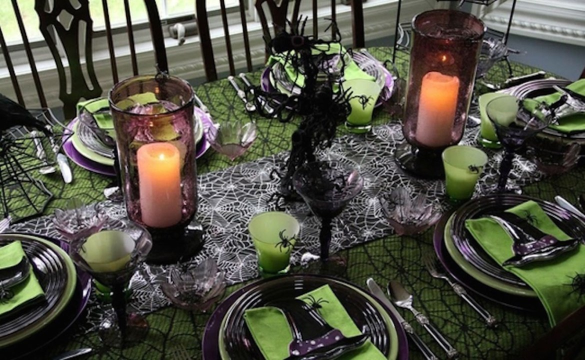 Halloween dinner setting with spiderwebs