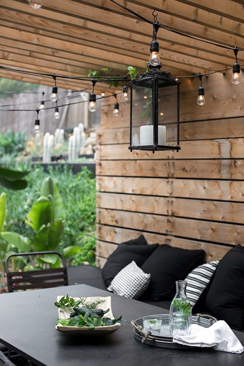 Hanging black lantern and string lamps
