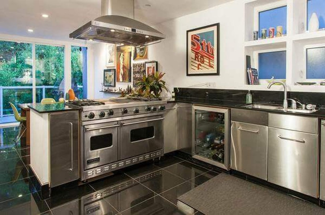 Modern black kitchen flooring with modern cabinet and white walls to look amazing
