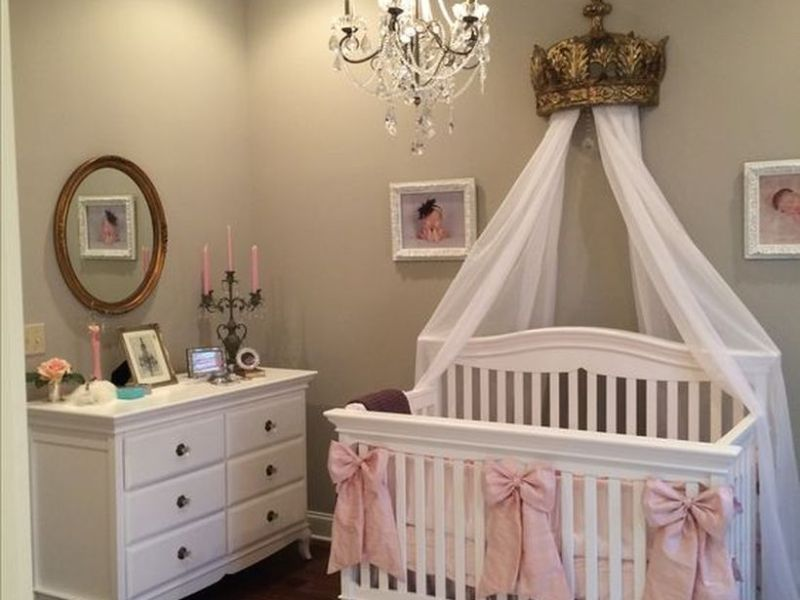 Queen-baby-girls-nursery-room-with-crown-accent-white-drappie-and-wooden-white-bed-for-your-baby